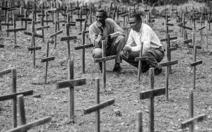 Two men grieve at mass grave of Rwandan genocide